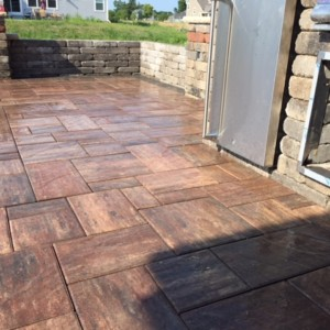 Patio with firepit & outdoor kitchen in Pewaukee