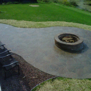 Patio installation with fire pit in Pewaukee, Wisconsin